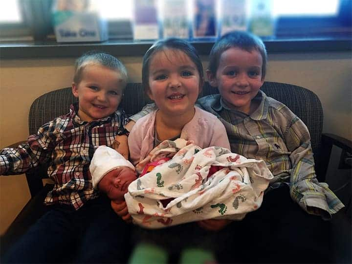Left To Right: Joel - 3, Amelia - 4, and Micah - 6, visit their new sister, Anna, at Holy Family Hospital
