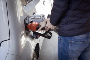 Person pumping gas into their car | Proposed gas tax | Deer Park Gazette